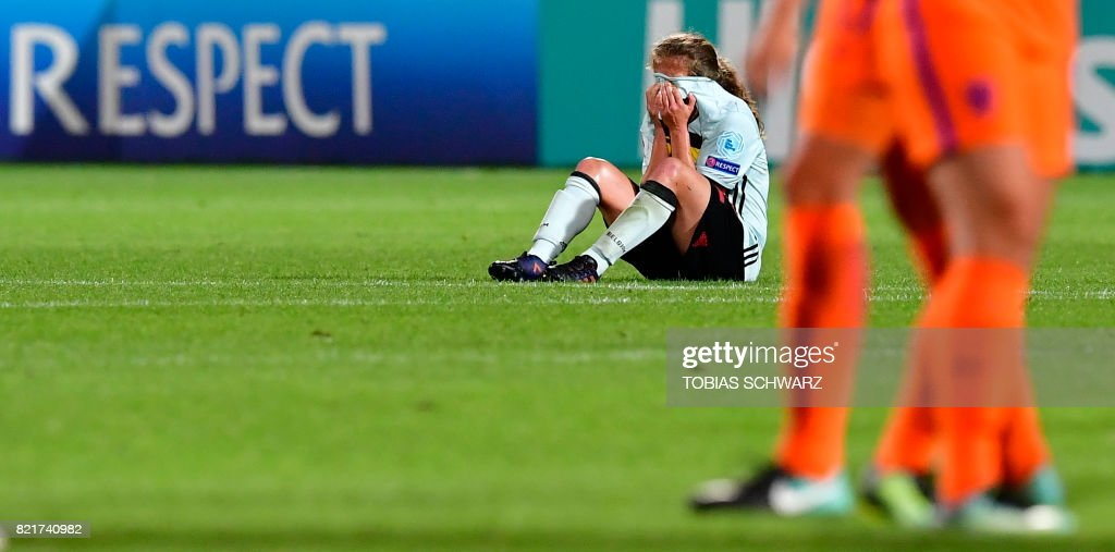 One of Belgium's players reacts after losing the UEFA Women's Euro 2017 football match between Belgium and the Netherlands at Stadium Koning Wilhelm II in Tilburg on July 24, 2017. /