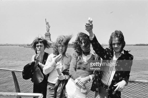 One of Britain's top pop groups Slade are pictured on their way to visit the Statue of Liberty and seen in the famous Manhattan Harbour They are in...