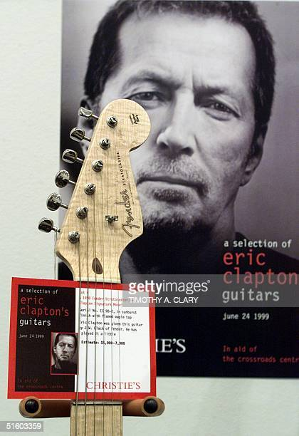 One of British guitarist Eric Clapton's Fender Stratocasters shown at a media preview 17 June 1999 will be auctioned along with 99 other guitars from...