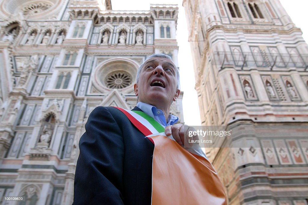 One of Central Italy's hundreds mayors protesting against the Berlusconi Government while parading through the streets on May 20, 2010 in Florence, Italy. Mayors of Central Italy have declared a major emergency of Commons because of the cuts and the rigidity of the Stability Pact asking the Government to loosen budget constraints. The mayors wearing tricolor sashes marched through the streets of Florence and then lay for a Flash Mob in Piazza della Signoria on banners reading ' Thay are knocking your municipality to the ground'