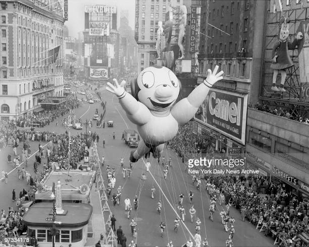 One of characters Mighty Mouse in the annual Macy's Thanksgiving Day parade mugs for the crowd as he hogs the spotlight in Times Square An estimated...