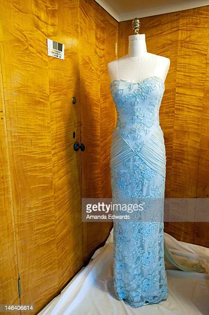 One of Diana Princess of Wales's dresses is prepped for display at the media preview for 'Diana Legacy Of A Princess' at the Queen Mary on June 15...