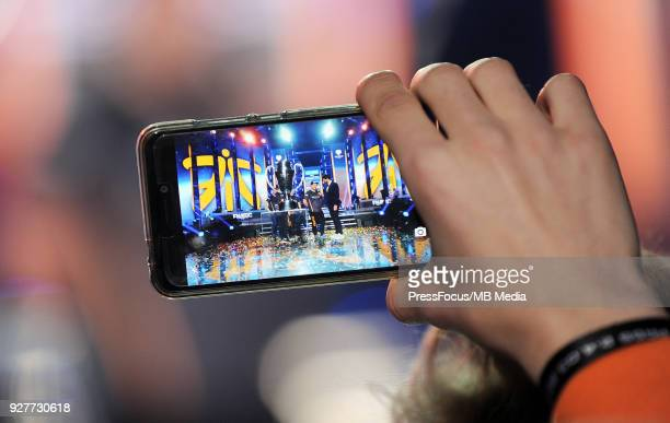 One of fans takes pictures of winners' cup during CounterStrike Global Offensive final game between FaZe Clan and Fnatic on March 4 2018 in Katowice...