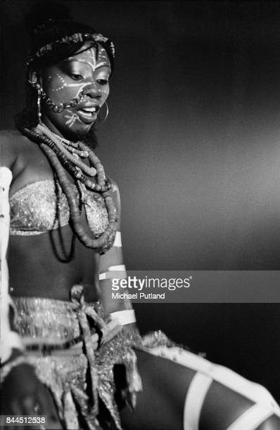 One of Fela Kuti's wives appears on stage with him in Paris 1981