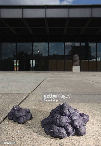 One of four piles of fake blue horse manure lies outside the Neue Nationalgalerie art museum on August 7 2012 in Berlin Germany The four piles are an...