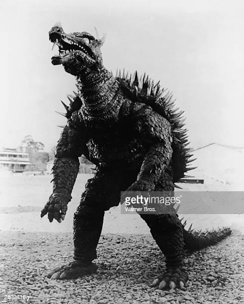 One of Godzilla's foes Anguirus stands on a rockstrewn beach in a still from 'Godzilla Raids Again' directed by Motoyoshi Oda 1955