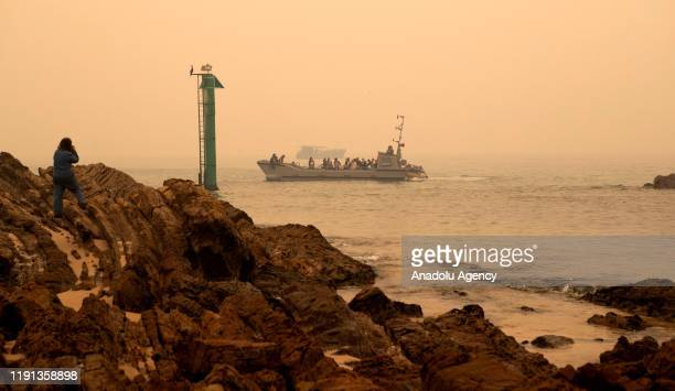 One of HMAS Choules' landing craft leaves Mallacoota with evacuees to be ferried to the ship in Victoria Australia on January 3 2020 The Australian...