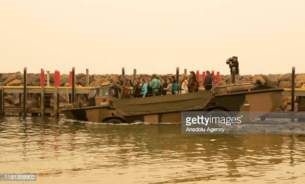 One of HMAS Choules' LARCs leaves Mallacoota with evacuees to be ferried to the ship in Victoria Australia on January 3 2020 The Australian Defence...