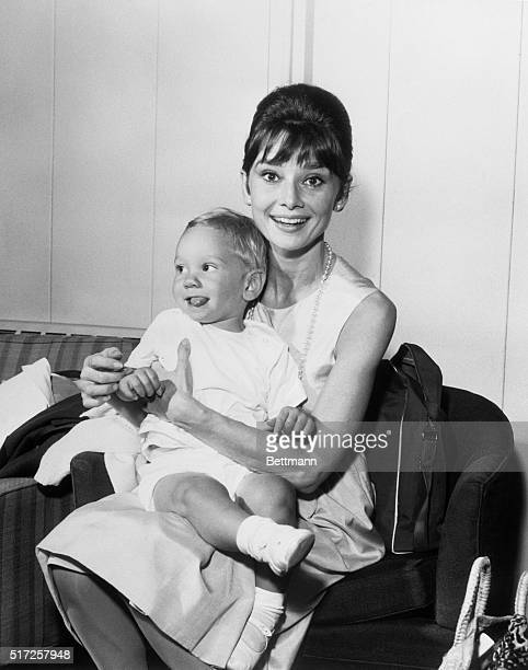 One of Hollywood's brightest stars, Audrey Hepburn has a joyful reunion with her son Sean, three years old, upon his arrival from Los Angeles via TWA...