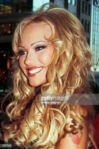 One of Hugh Hefner's twin girlfriends celebrates the upcoming May issue of Playboy magazine April 12 2000 in New York City The cover features twins...