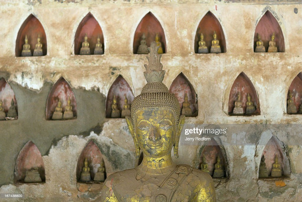 One of hundreds of Buddha statues in an alcove in Wat Sisaket, which is now a museum dedicated to Lao Buddhism. The building is the oldest temple in the city..