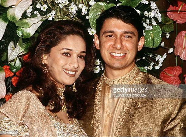 One of Indian Bollywood's most beautiful actresses Madhuri Dixit with her doctor husband Sriram Nene at a wedding reception 18 December 1999 with...