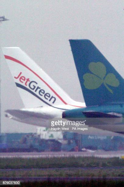 One of Jet Green's aircraft stands on the tarmac at Dublin airport as an Aer Lingus plane taxi's past in Ireland The company was forced to cancel all...