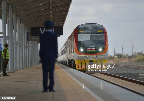 One of Kenya's newly acquired standard gauge rail locomotive carrying Kenyan President pulls into Voi railway station on May 31 2017 in Voi during an...