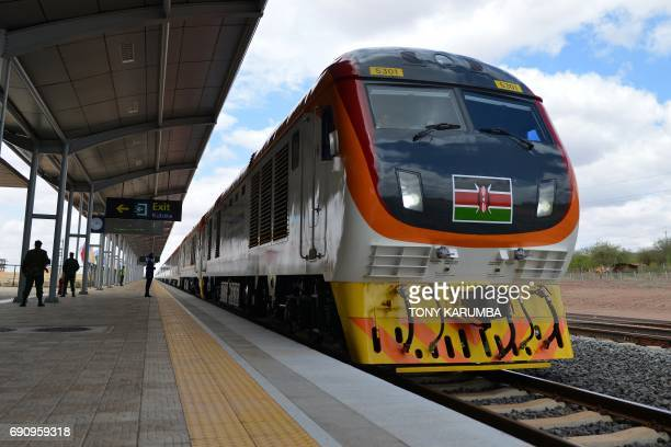 One of Kenya's newly acquired standard gauge rail locomotive, carrying Kenyan President pulls into Voi railway station on May 31, 2017 in Voi, during...