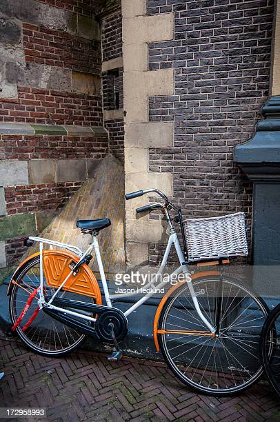 One of many beautiful cruisers in Amsterdam, leaning on the Nieuwe Kerk in The Netherlands.