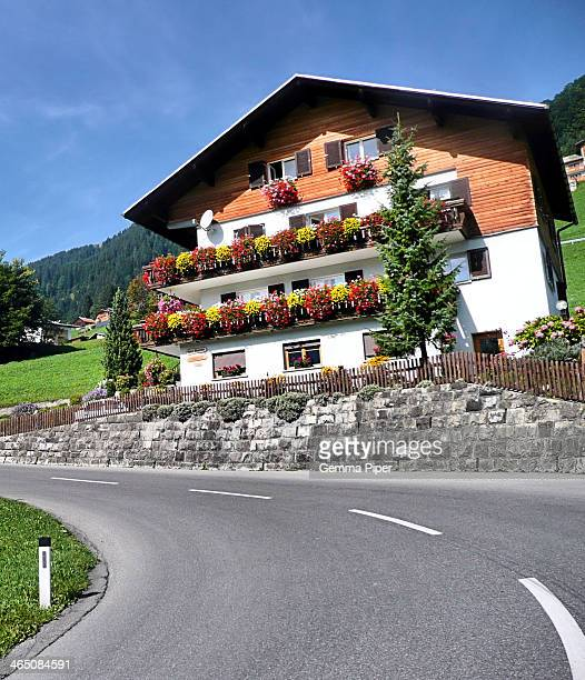 One of many beautiful mountain chalet homes, with traditionally decorated balconies, located in the Vorarlberg region of Austria during late summer