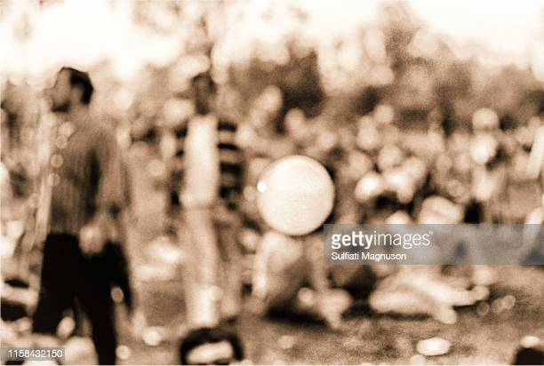 One of many bubbles being blown floating across the panorama of the crowd at the 1st Elysian Park Love-In on March 26, 1967 in Los Angeles,...