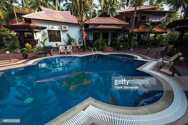 One of many luxurious wellness resorts with swimming pool and huts on the north cliff of Varkala beach