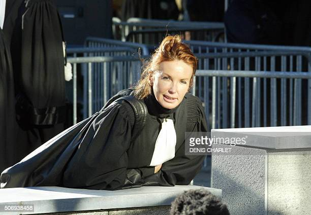 One of Marc Dutroux's lawyers Martine Van Praet is pictured in front of Arlon's courthouse on the second day of Dutroux's trial 02 March 2004 The...