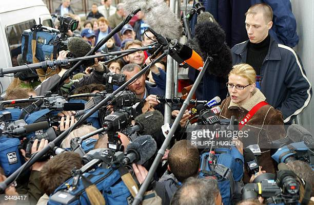 One of Marc Dutroux's victims Laetitia Delhez speaks to the press after testifying after the end of the days session in the trial of convicted...