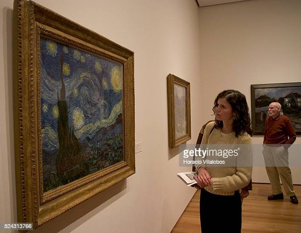 One of MoMA's many visitors contemplates Vincent Van Gogh's painting 'The Starry Night' New York's Museum of Modern Art reopened last November 20th...