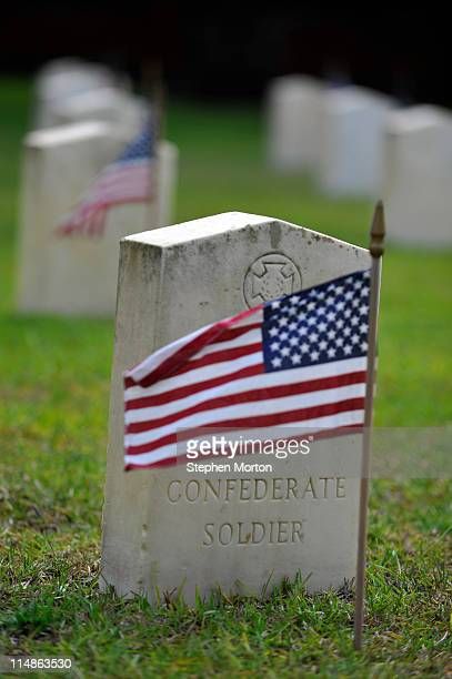 One of more than 18000 American flags marks the grave of an unknown Confederate soldier at the Beaufort National Cemetery May 27 2011 in Beaufort...