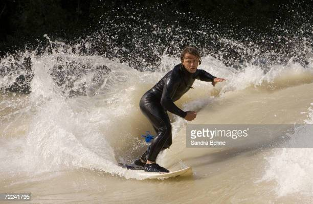 One of Munich's Isar River Surfers surfs on the Isar river at Wittelsbacher bridge on August 9 2006 in Munich Germany The standing wave in Munich...