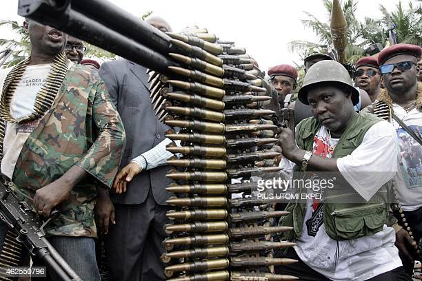One of Nigeria's key militant leaders in the volatile oil hub of the Niger Delta Ateke Tom examines an anti aircraft gun surrendered to the Nigerian...
