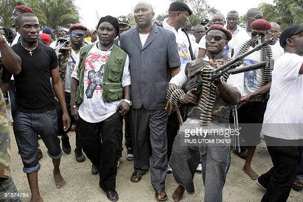 One of Nigeria's key militant leaders in the volatile oil hub of the Niger Delta Ateke Tom arrives to surrender arms and ammunition on October 3 2009...