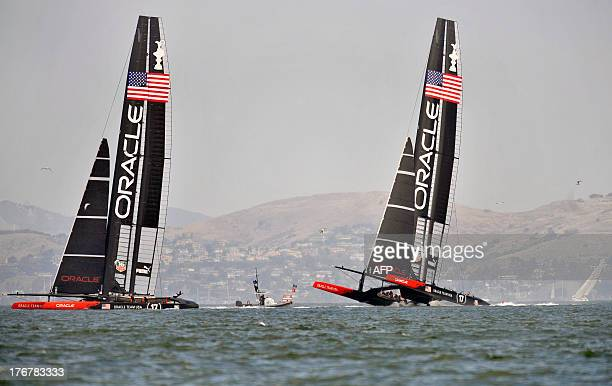 One of Oracle Team USA's AC72s rises partially out of the water during a practice run in San Francisco California on August 18 2013 The practice run...