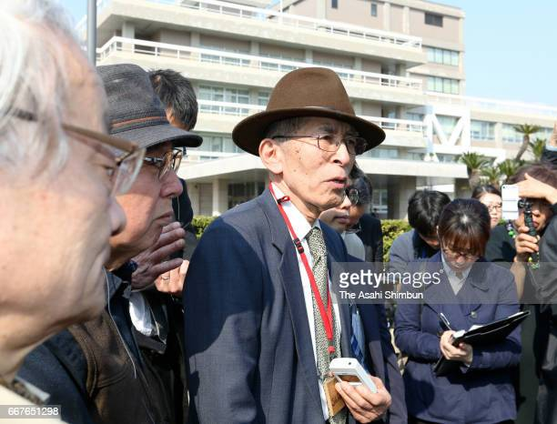 One of plaintiffs speaks to media reporters after the request of a temporary injunction on the Ikata nuclear plant had been rejected in front of the...