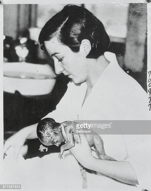 One of Quintuplets Prepared for Her Bath Callander Ont Can While the famous Dionne girl quintuplets are gaining weight a great deal of credit is...