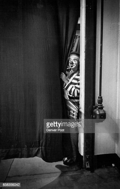 One of Ringling Brothers clowns waits behind the curtain on clown alley for the opening of the afternoon performance held for handicapped and the...