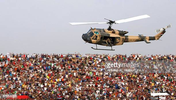 One of several helicopters fly over a packed AlShaab stadium in the Iraqi capital Baghdad on August 24 2008 prior to the start of the finals of the...