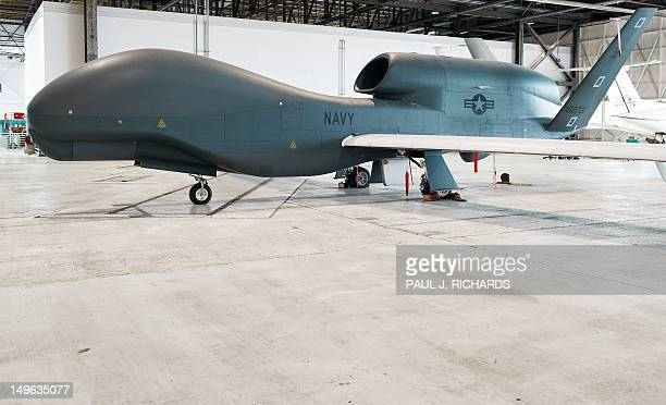 One of several the US Navy's Northrop Grumman MQ04C Broad Area Maritime Surveillance Unmanned Aircraft Systems is seen in a hangar July 31 2012 at...
