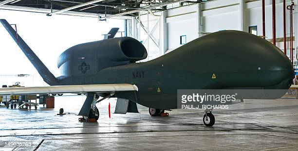 One of several US Navy Northrop Grumman MQ04C Broad Area Maritime Surveillance Unmanned Aircraft Systems is seen in a hangar July 31 2012 at Naval...