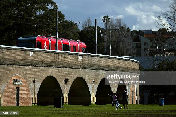 One of Sydney's light rail trains passes over the viaduct at Glebe on its run to Central station this afternoon 3 August 2006 SMH Picture by JON REID
