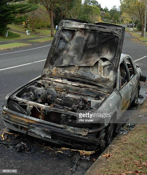 One of the 11 cars that was set alight in arson attacks on cars overnight around the Howick area in Auckland New Zealand Wednesday May28th 2004