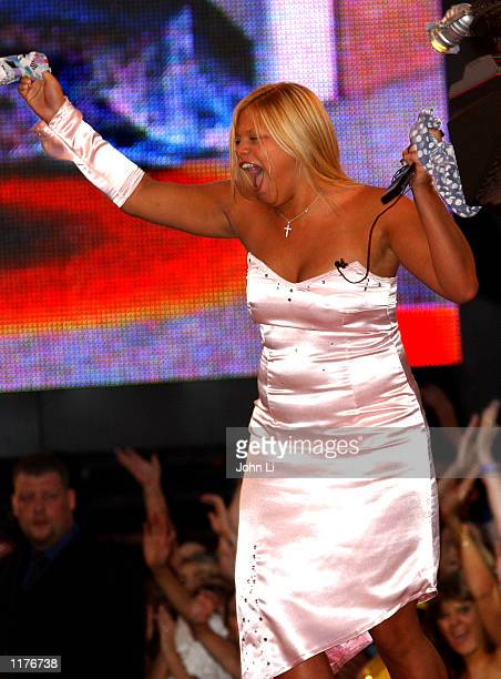 """One of the 3 runners up of the final of """"Big Brother 3"""" reality TV series, Jade, greets the crowd outside the Big Brother House on July 26, 2002 in..."""