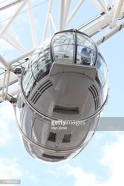 CONTENT] One of the 32 ovoidal capsules of the London eye capsule at the South Bank of the River Thames in London England