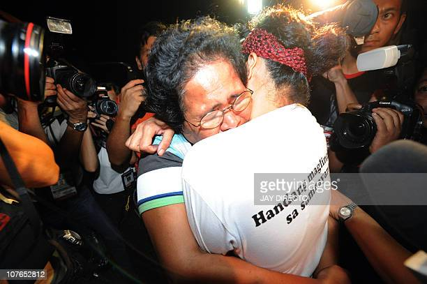 One of the 43 freed health worker Jane Valleta hugs her mother as they find their way out of the crowd from a Metro Manila Detention Jail in Taguig...