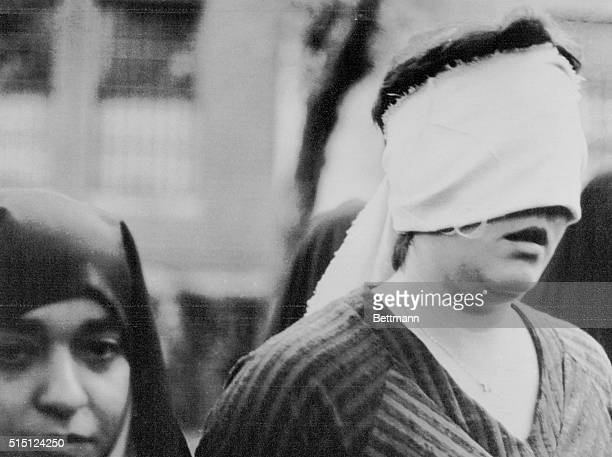 One of the American woman hostages led outside the United States embassy building on the first day of the occupation 11/4 photographed by an Islamic...