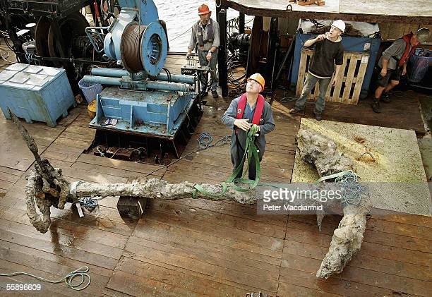 One of the anchors of Henry VIII's flagship Mary Rose is seen as it is brought ashore at the Royal Naval Dockyard on October 11 2005 in Portsmouth...
