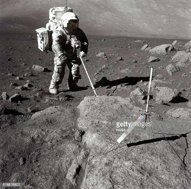 One of the Apollo 17 astronauts uses a thin metal pole to get a core sample on the surface of the Moon | Location TaurusLittrow Valley Moon