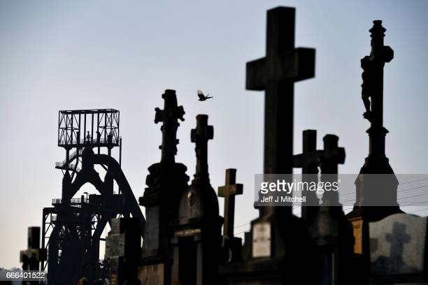 One of the ArcelorMittal blast furnaces is viewed through gravestones in a cemetery on February 14 2017 in HayangeFrance The people of the French...