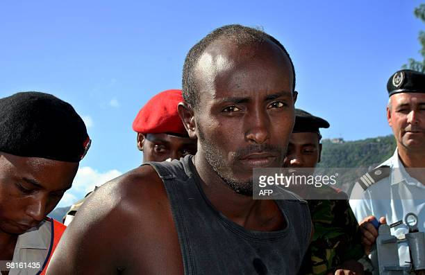 One of the arrested Somali pirates is handed over to police upon his arrival on March 31 2010 in the Port Victoria with the six Seychellois fishermen...