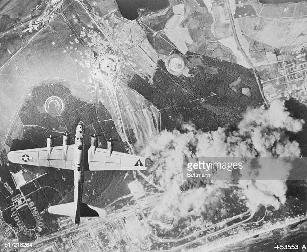 One of the attacking B17 flying fortresses of the United States Army 8th Air Force passes over the burning target area during an attack on the...