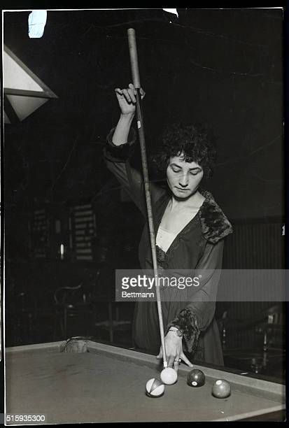 One of the best women's billard and pool players in the US Unidentified woman undated photograph She is holding the cue vertically with a look of...