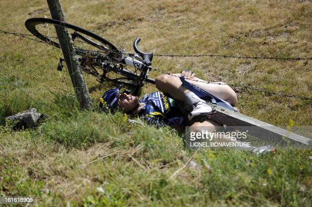 One of the breakaway men Netherland's Johnny Hoogerland is seen after he crashed and landed in a fence at the side of the road during the 208 km and...